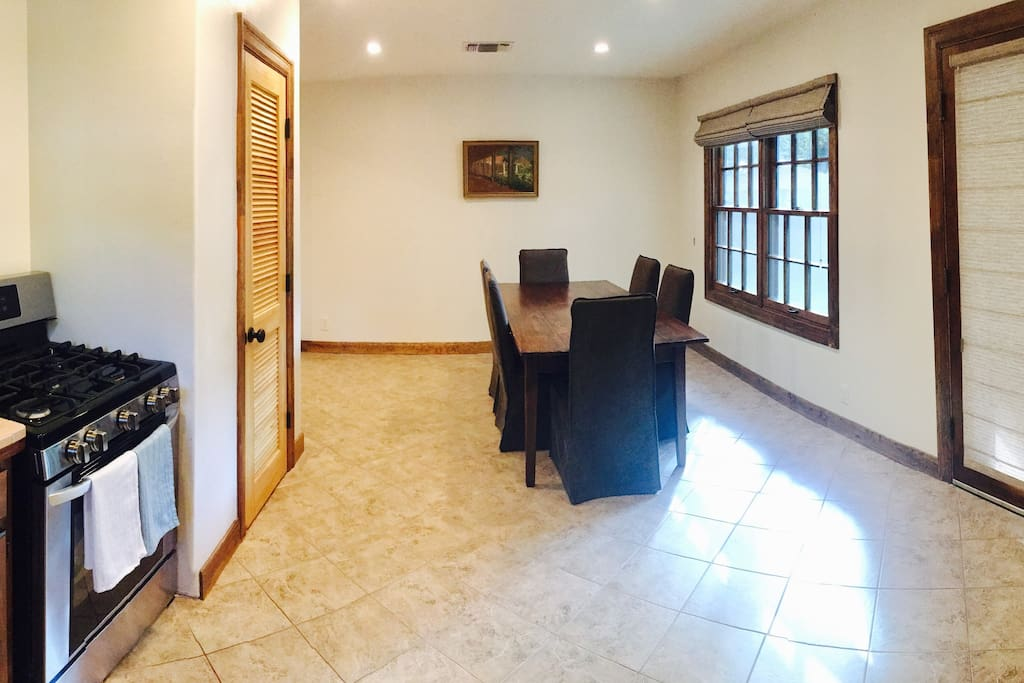 Large, bright dining area with beautiful hardwood tabley