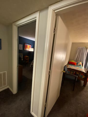 On the right side of the hallway- Bedroom one with two twins, Bedroom two with king size tempurpedic bed. Pack n play in closet if needed