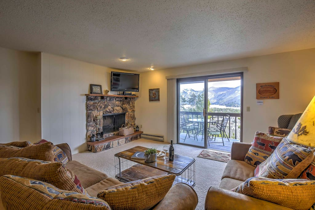 The cozy condo features a real wood-burning fireplace, flat-screen TV and comfy furniture.