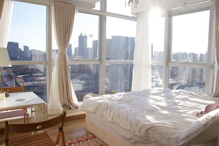 柒月民宿|【摩洛哥】东区和谐公园旁/全景落地窗/流苏阳光房/带厨房/暖气
