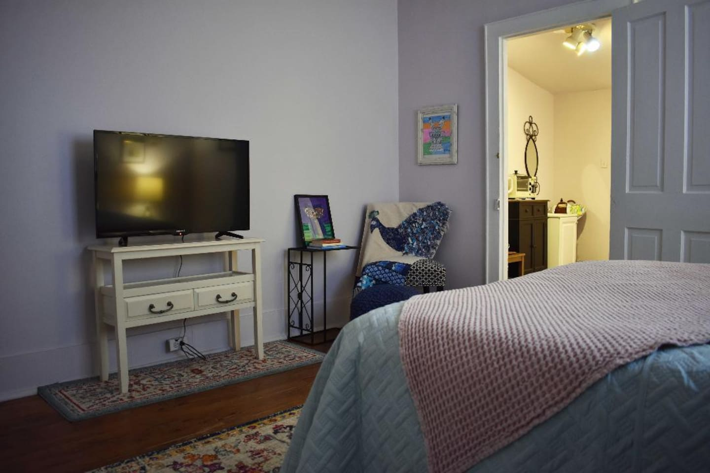 Cozy and chic private guest quarters with roomy bedroom, walk-in closet, kitchenette and bathroom.