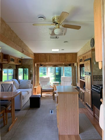 View of kitchen/living area in 5th wheel trailer.
