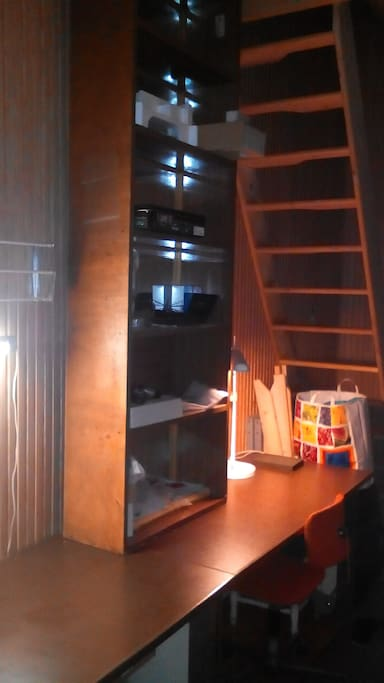 Half room with stairs of gallery.
