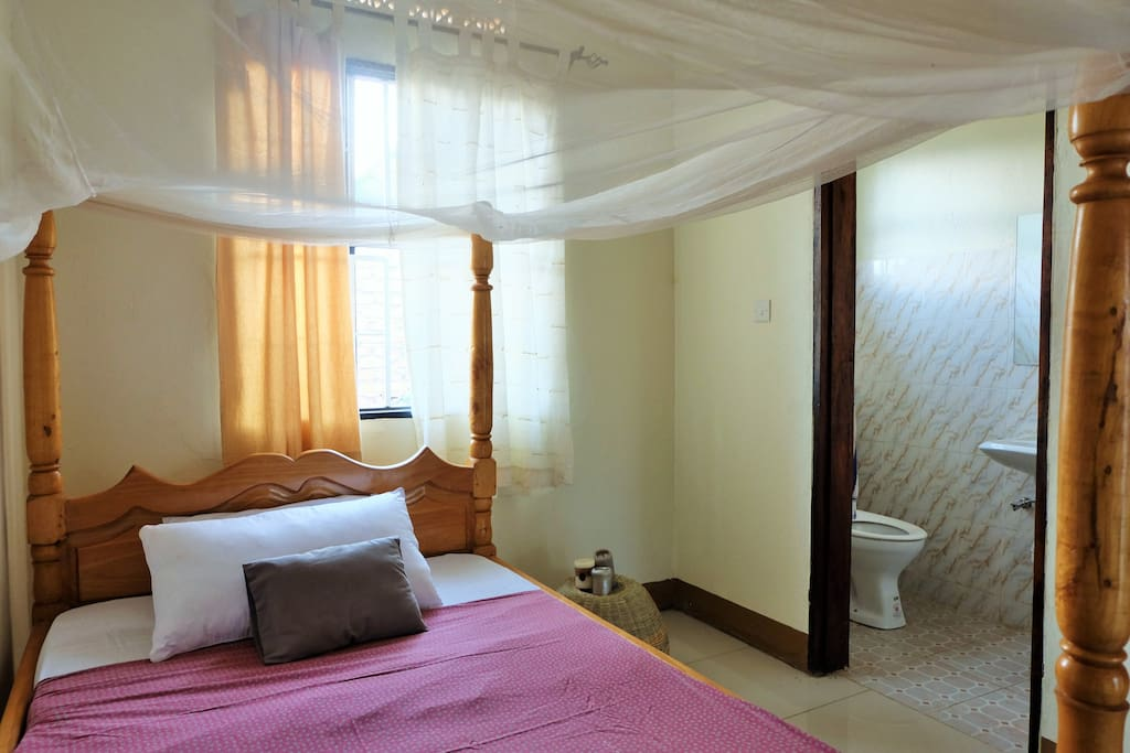 Bedroom with private bathroom and shower