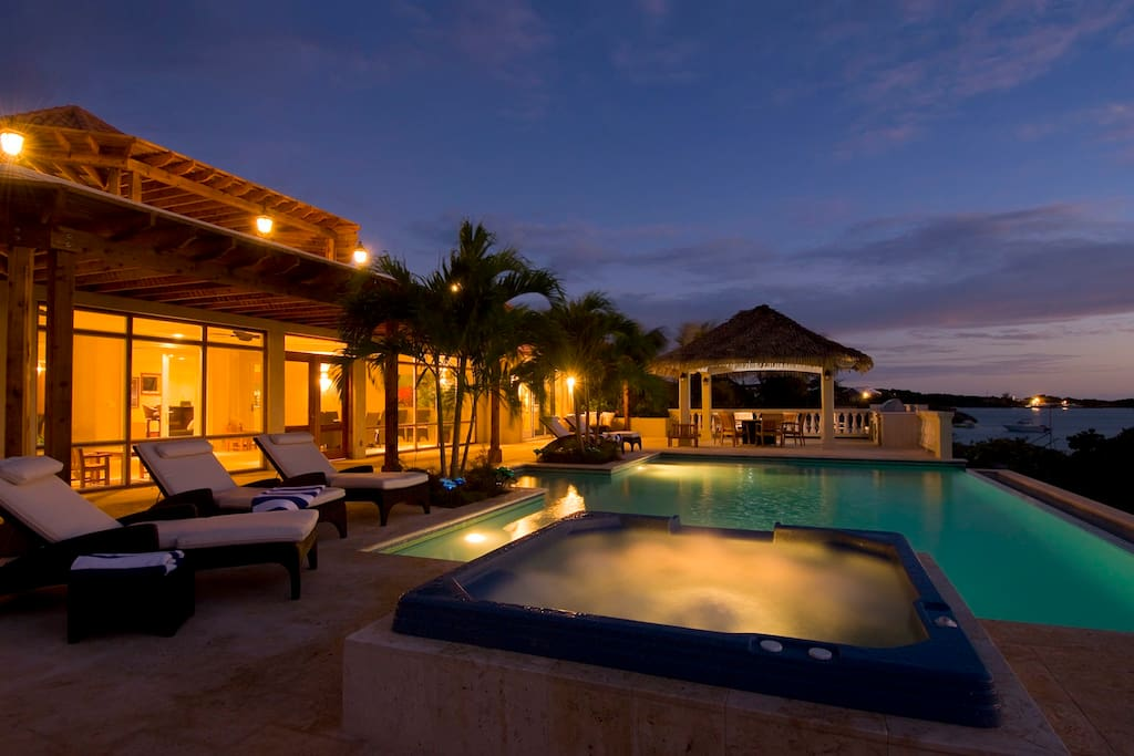 Incredible pool and hot tub at night