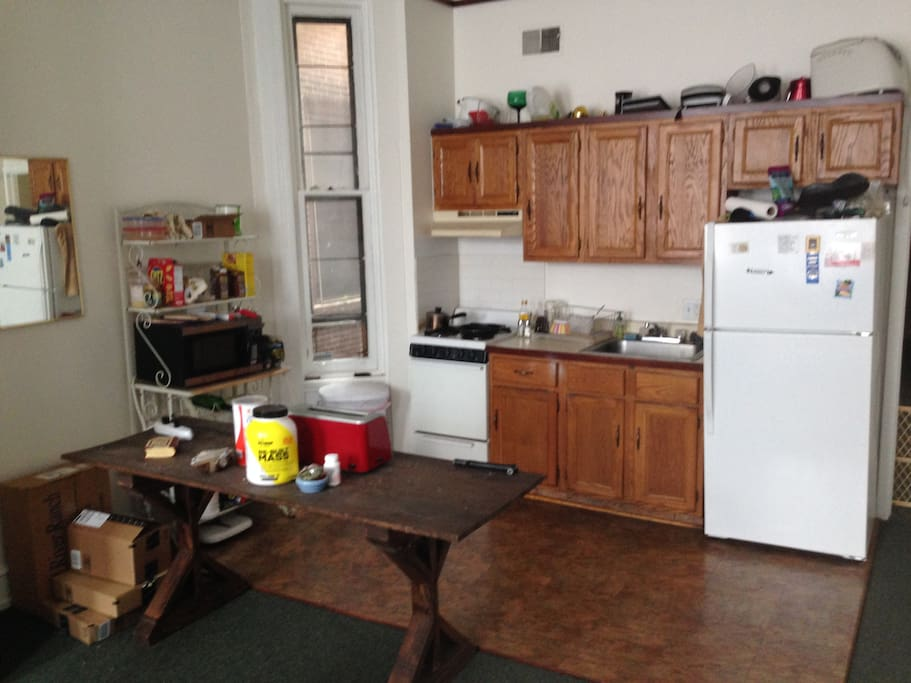 The kitchen on the other end of the main room