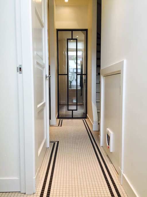 This is the entrance with the classic mosaic floor and steel framework doors
