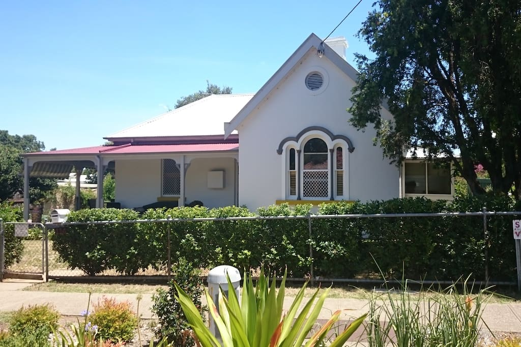 Large country home only 200m from city CBD and a block from railway station.