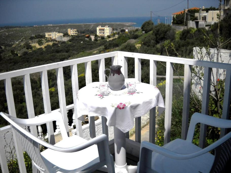 Having some of our Cretan wine on your spectacular view deck ....