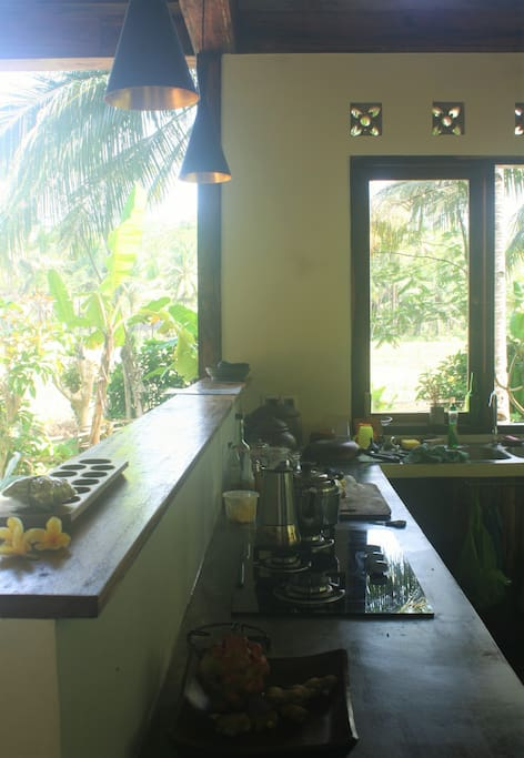Prepare your own meals in our spacious kitchen. There's a gas stove and a fridge. Coffee and tea are provided