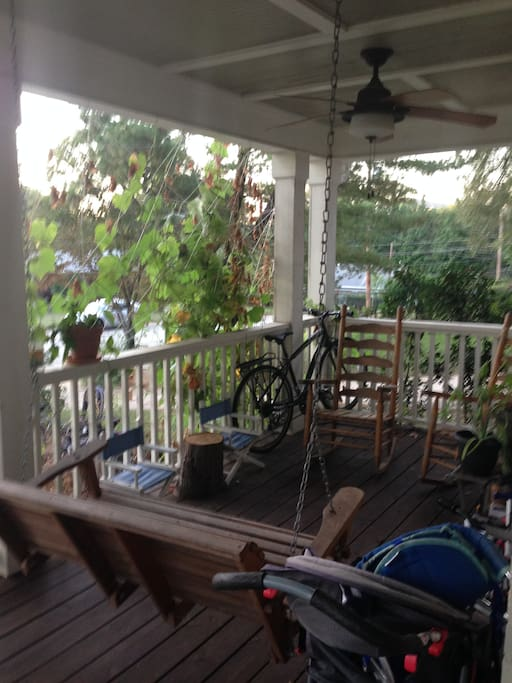 Front porch with swing and ceiling fan