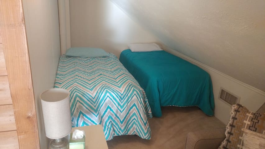 Two twin size beds on second floor