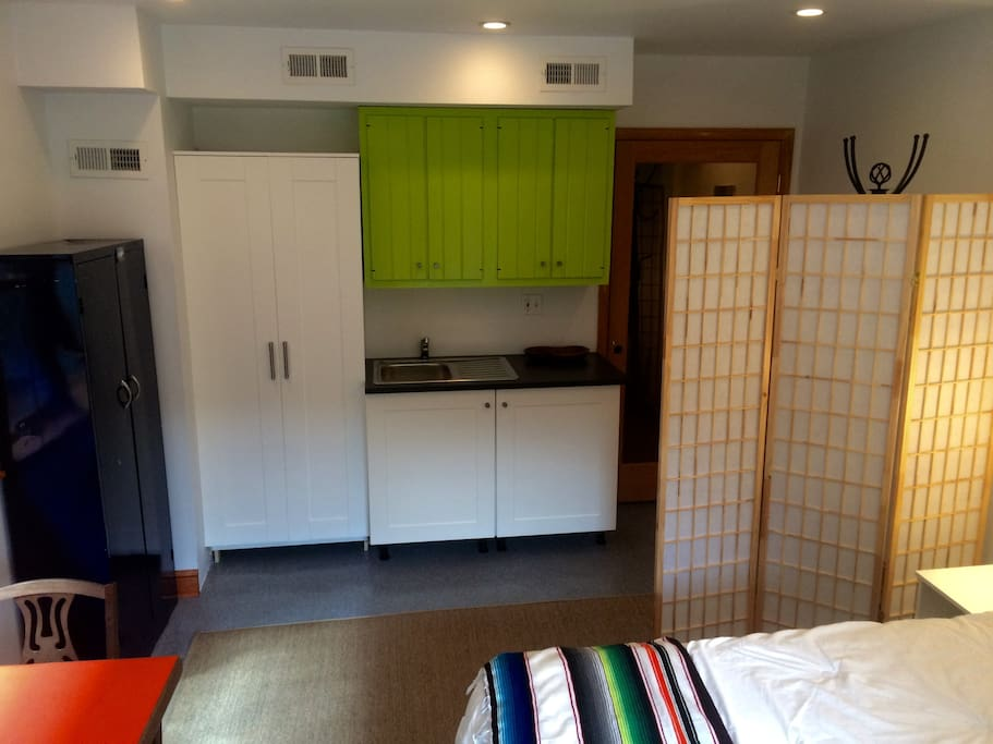 Kitchenette with sink, mini-refrigerator, coffee-maker, and microwave.