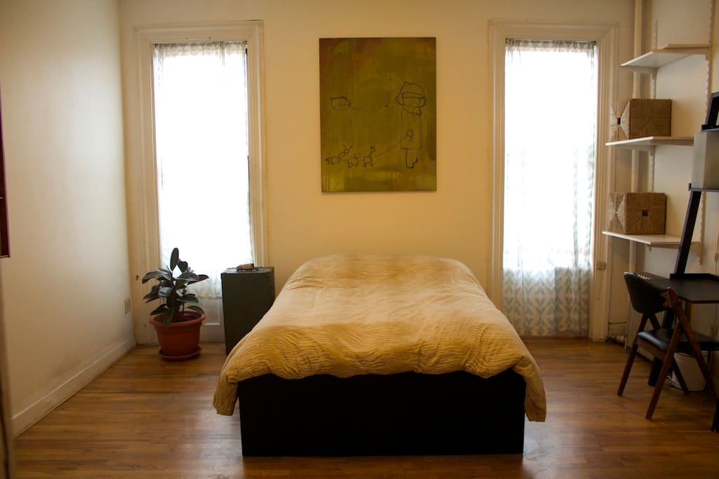 Huge bedroom with plenty of space for a couple with lots of natural sunlight.