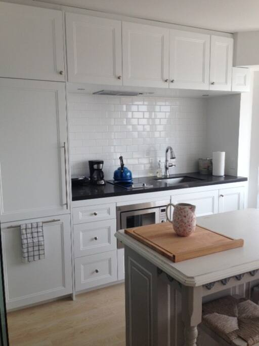 Full size kitchen with brand new appliances including full fridge, freezer, stove, oven, microwave, dishwasher, Large stainless steal sink and faucet. All cookware including dishes and additional appliances are included and available for use including cle