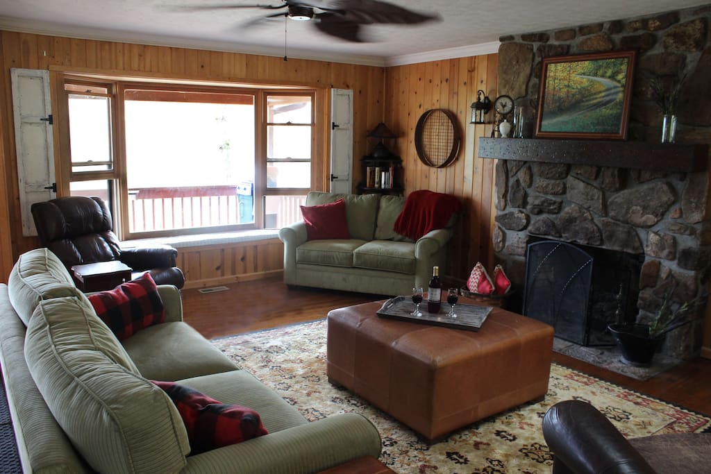 Family room with 2 leather recliners, couch, loveseat bay window and fireplace.