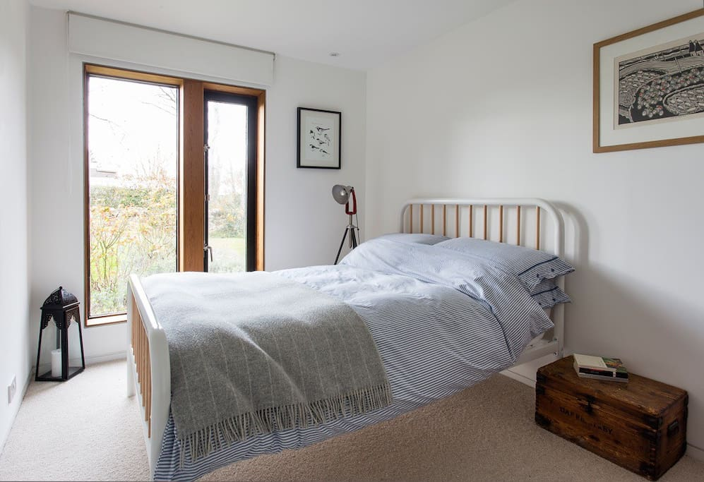 The Bedroom with view out to the garden
