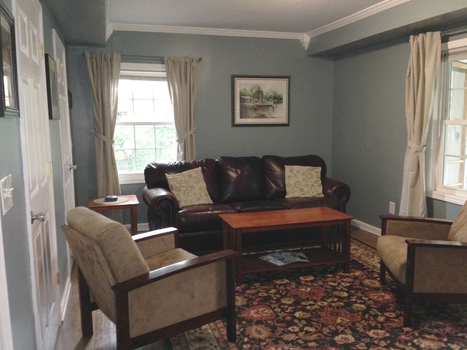 This is a relaxing room, great for entertaining.  Guests can spill out into the covered, screened in porch.   Comfortable leather couch, 2 micro fiber chairs, laundry room is off to the left, you enter from the right.