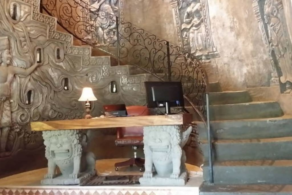carved out of mountain with beautiful railing to go upstairs to the second floor living area and to find 2 beautiful bedrooms
