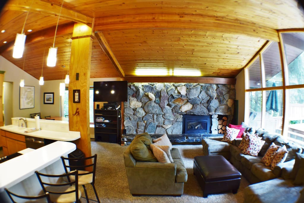 This is the primary living room area of the house. It contains a new fireplace as well as a clear view of the mountain.