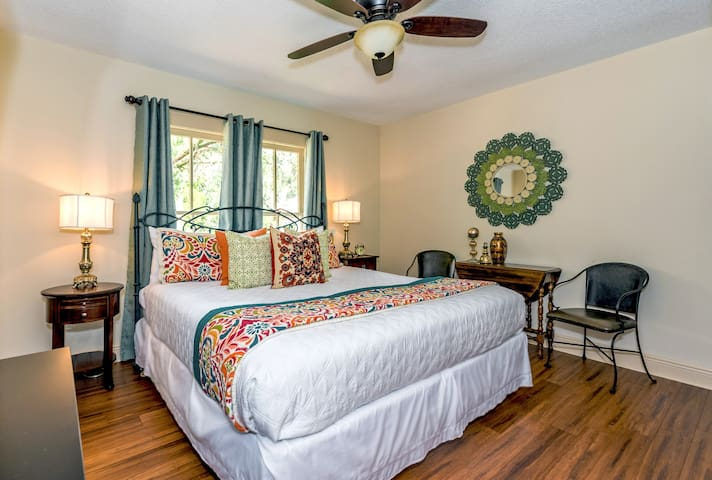 "Vintage 1920's Inn!  100 Steps to St. George Street!  The ""Magnolia"" room has a king bed private bath with shower and features easy access to our lovely rear porch with serene courtyard views!"