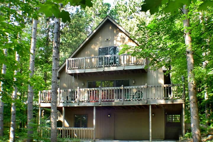 Stunning two-story home in the trees w/ a firepit, furnished deck, & balcony!