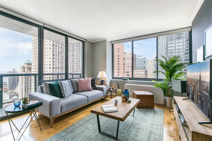 Bright + Airy Theater District 1BR w/ Gym, Doorman by Blueground