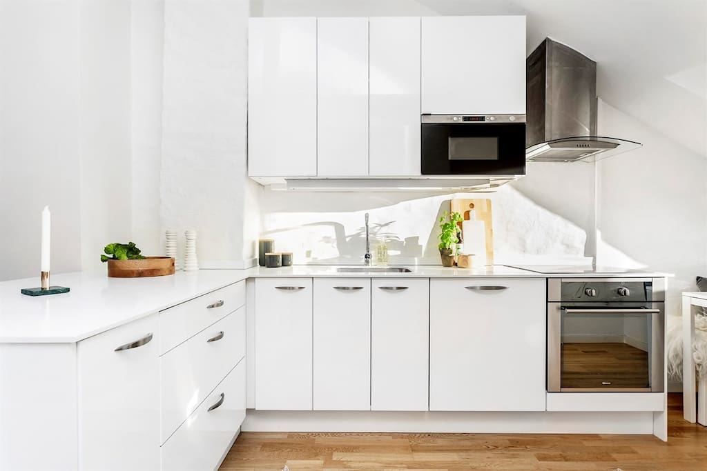 Bright kitchen with plenty of space for home cooking.  Supermarket right across the street.