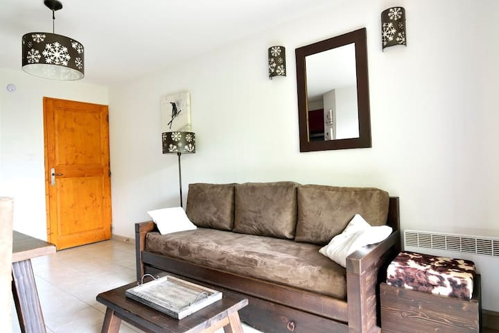 Sit back on this comfy sofa in the lovely living area.