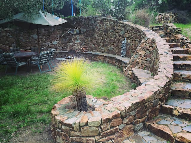 Amphitheatre with fire pit and outdoor shower (warm water)
