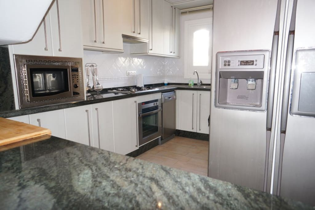 Full working kitchen incl dishwasher, large fridge with filtered water, oven, microwave, crockery, cutlery, gas hob, toaster, kettle