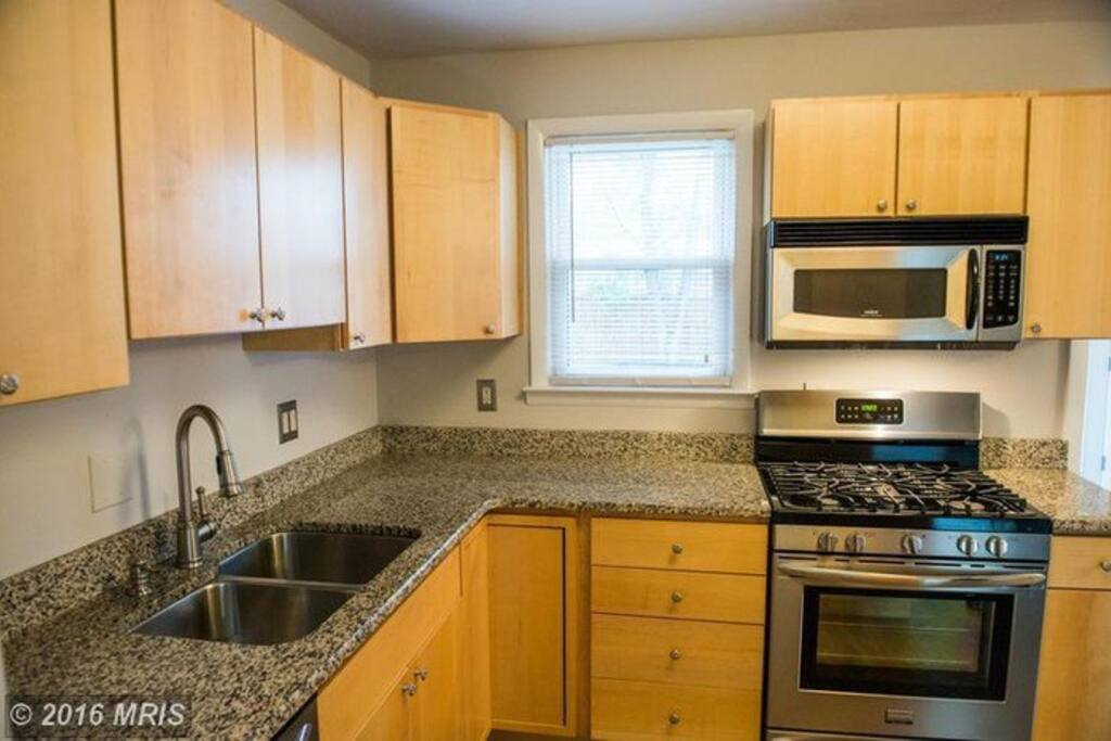 Modern Kitchen to cook in until stove is added to kitchen in the basement.