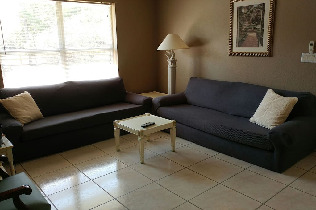 Current living area layout with new soft slip covered sofas. Truly great for sleeping.