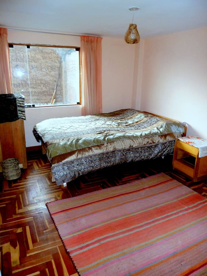 Your large room (photo shows 1 bed, we'll add a second when needed)