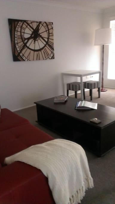 The large living room has a table/desk