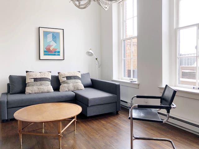 Living Room. Featuring a sleeper sofa that transforms into a full bed.