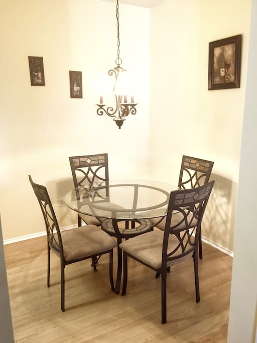 Beautiful dining area with seating for four.
