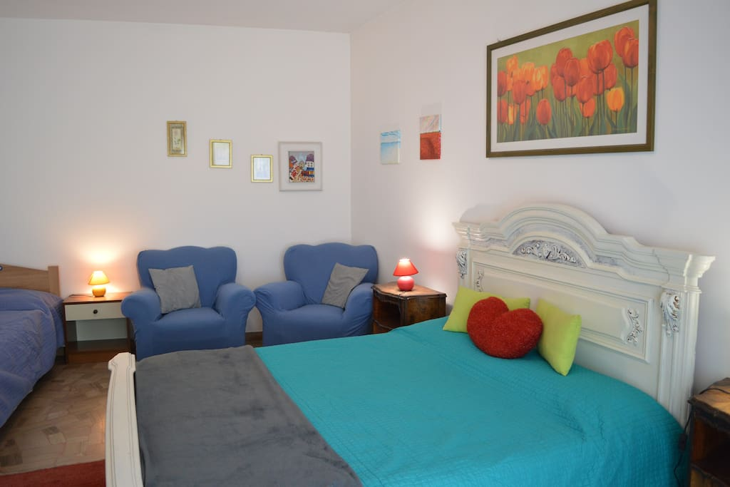 Bigger room with double bed and single bed