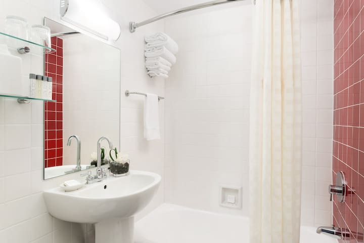 Guestroom Bathrooms feature PURE toiletries and bath towels.