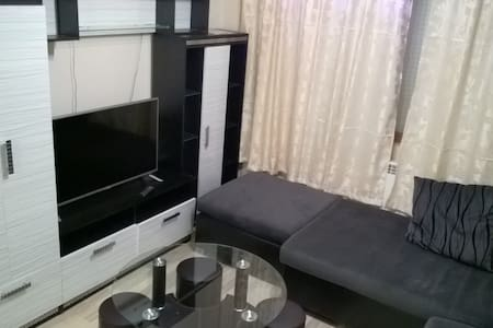 The apartment has 3 bedrooms and 2 bathrooms. There is a huge living room, with all amenities one can require. Its 15 mins walk from the sea garden of Burgas and the beach.