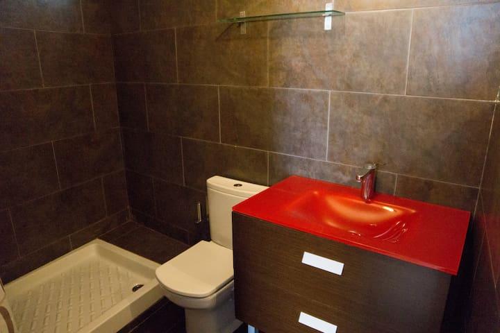 Enlarge bathroom with large shower.