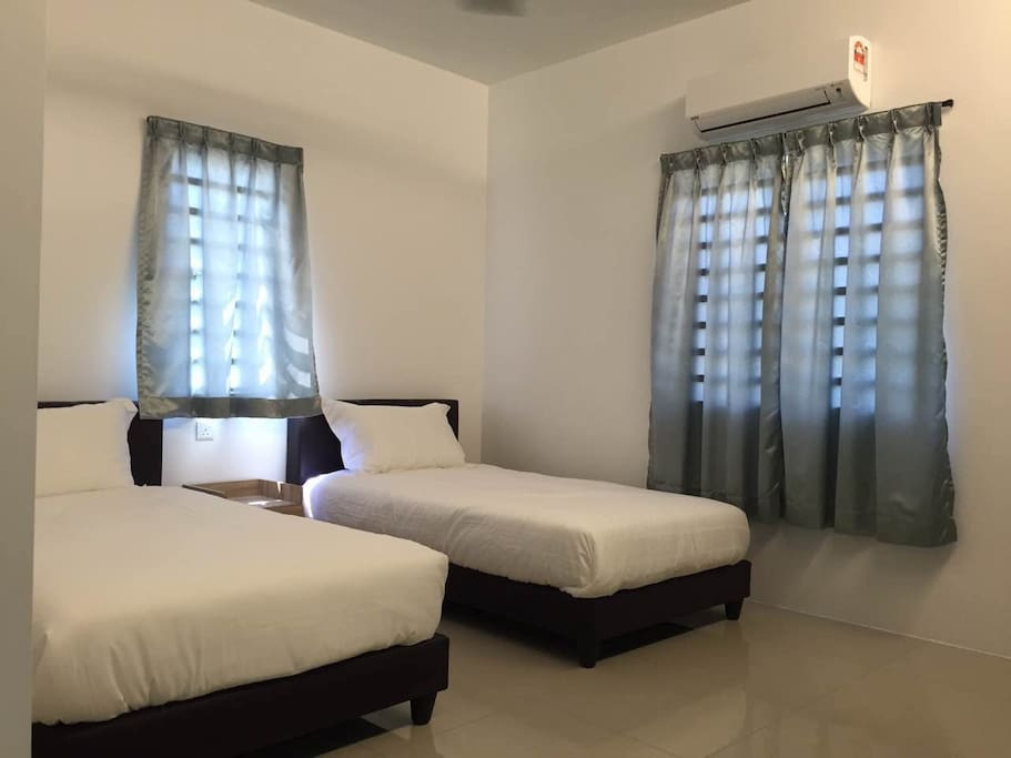 Bed for two pax , window provided , 4 star king koil mattress , Eco   Air conditioner , fan , console table and chair ,Tv
