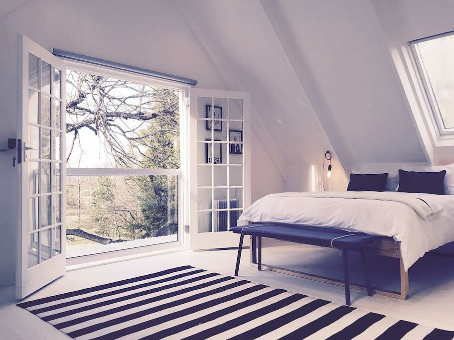 Main bedroom with opening French doors and juliette balcony