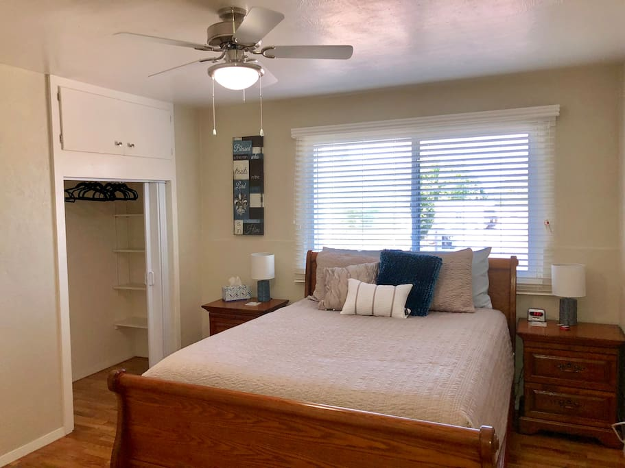 Brand new queen-sized bed in a spacious, peaceful room.
