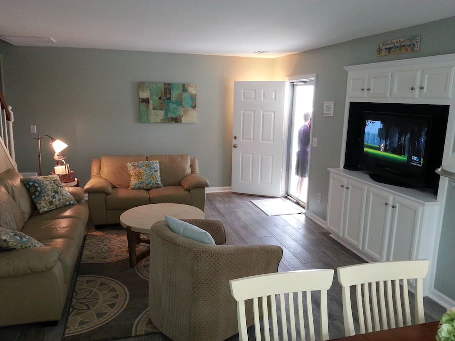 Recently renovated living room with flat screen entertainment