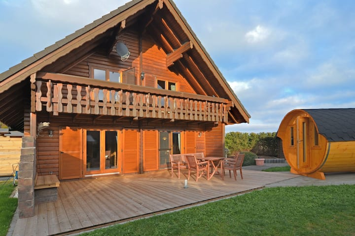"""Exclusive holiday home in the Sauerland with """"sleeping barrel"""", balcony, garden and terrace"""