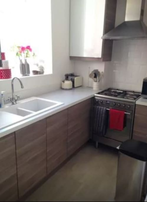 Newly refurbished kitchen with appliances including washer dryer and dishwasher
