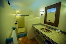The kitchen and bathroom are designed with traditional hand-painted talavera tile.