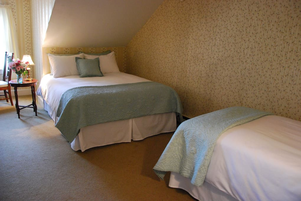 Room 6 has a queen and a single bed, is very quiet with a north facing window, desk, dresser, and private bath.