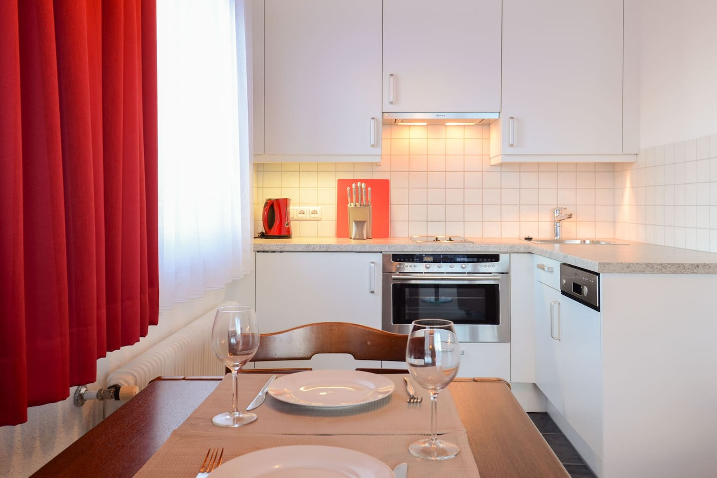 Kitchen fully equipped with coffee machine, dishwasher,oven, microwave and refrigerator